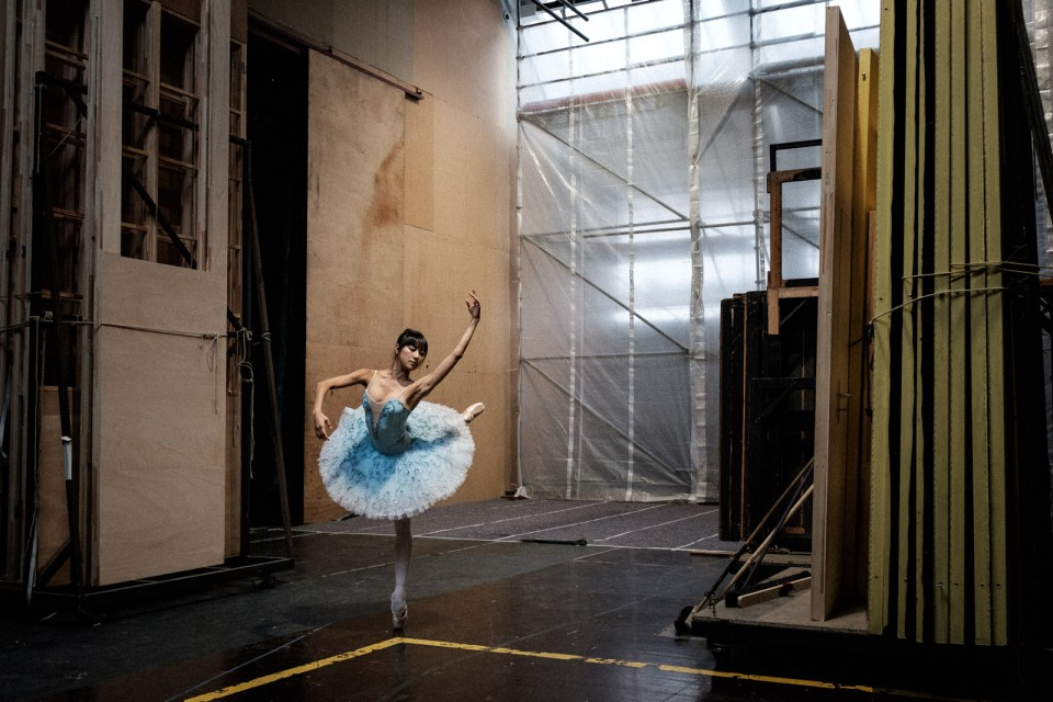 Ballerina warming up backstage with dancing dynamic pose in berlin staatsballett