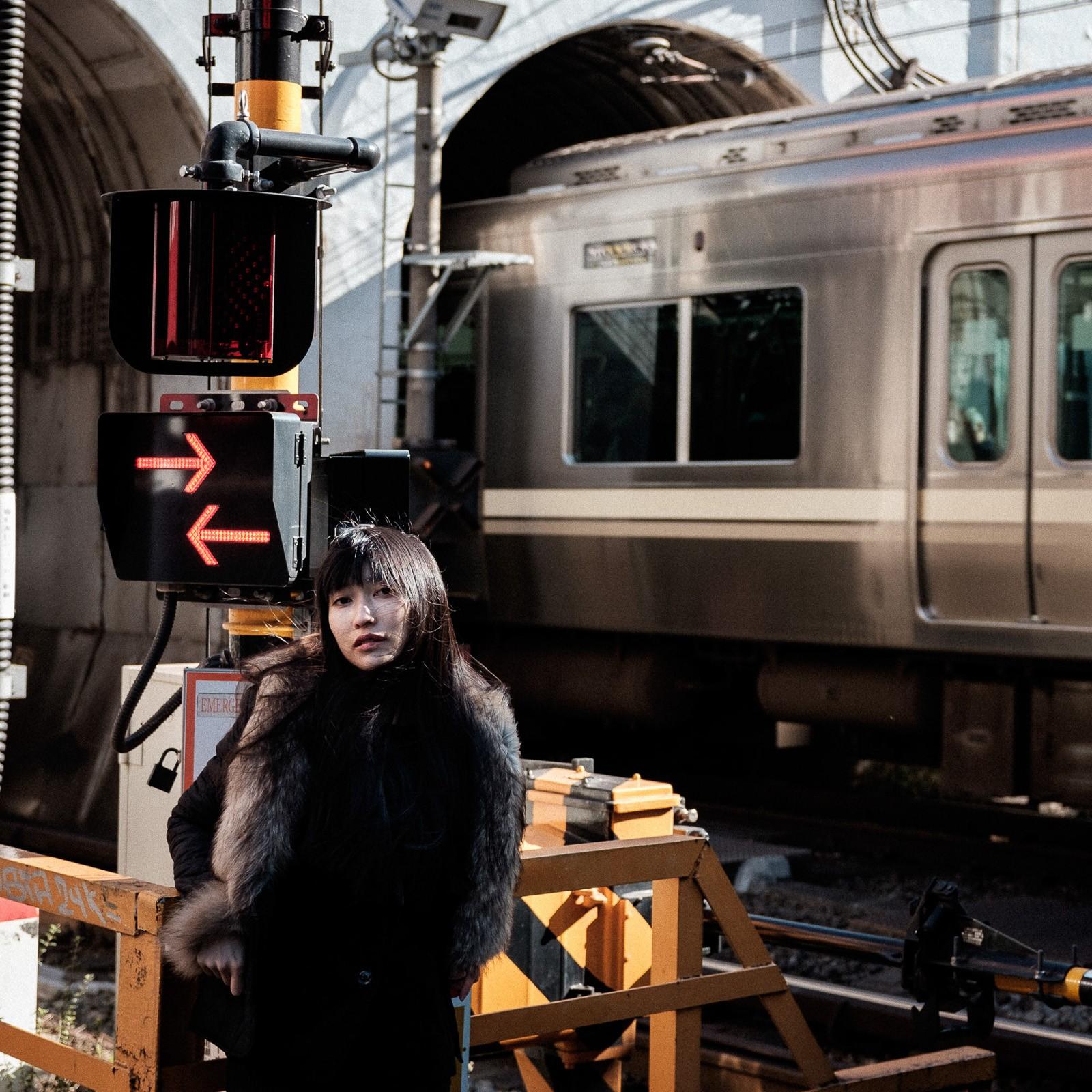 japanese woman posing at shinsen sation in tokyo