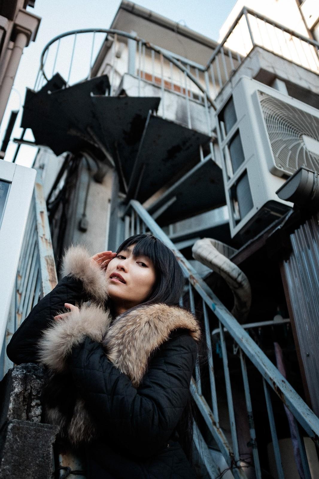 japanese woman posing on tooftop in tokyo