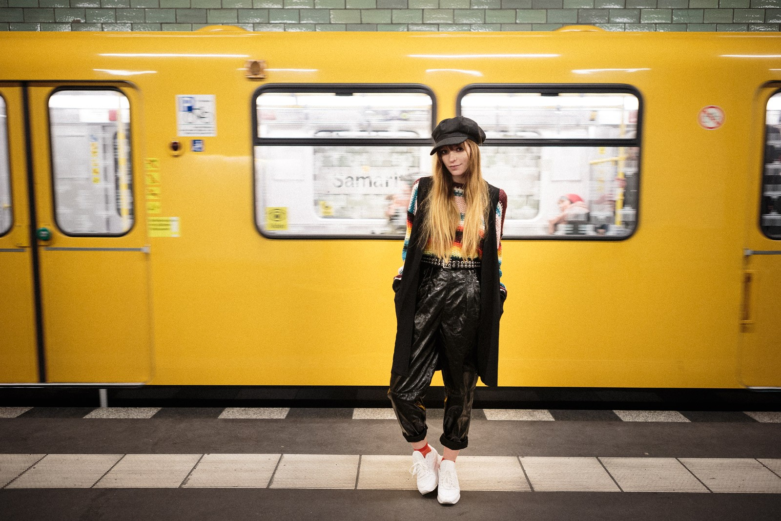 girl with hippie outfit in berlin subway