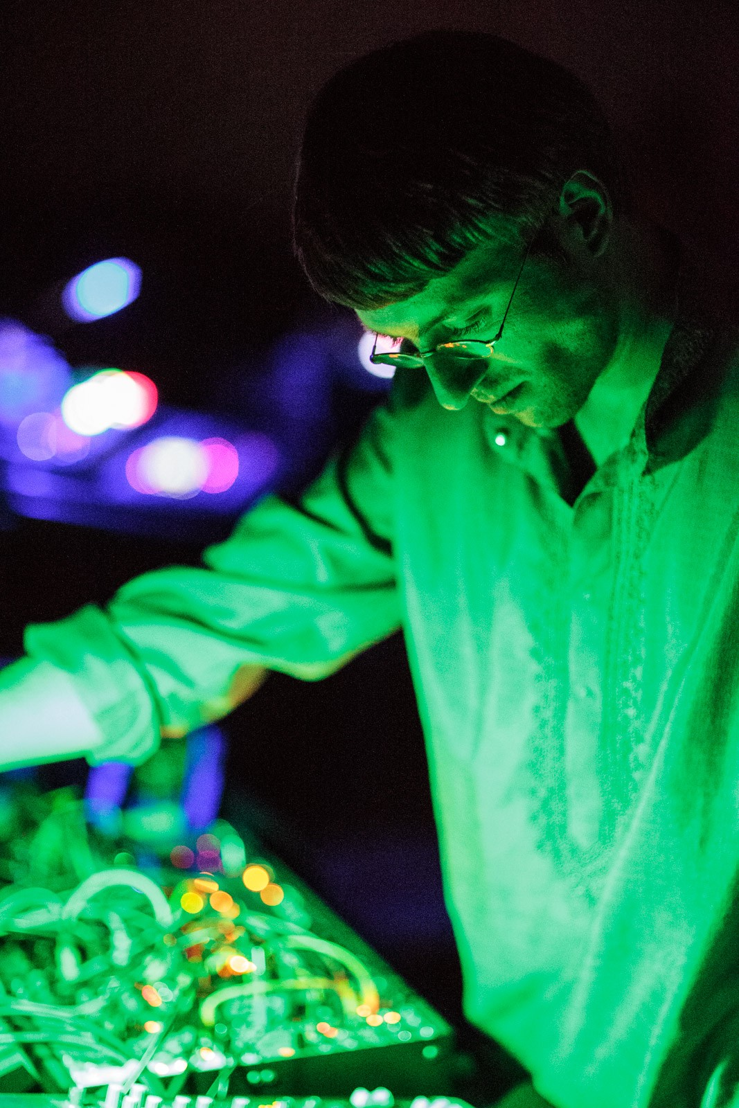 portrait of electronic musician in green light