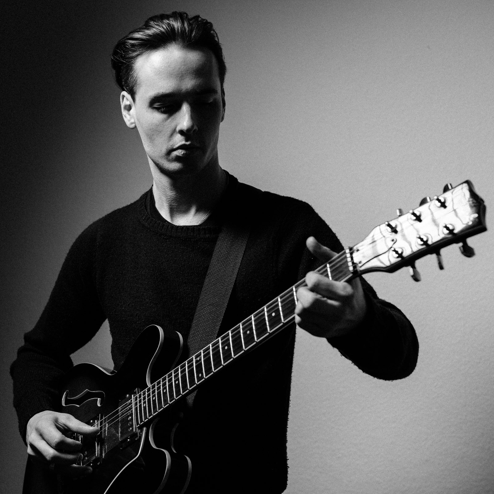 guitar musician black and white portrait shadow