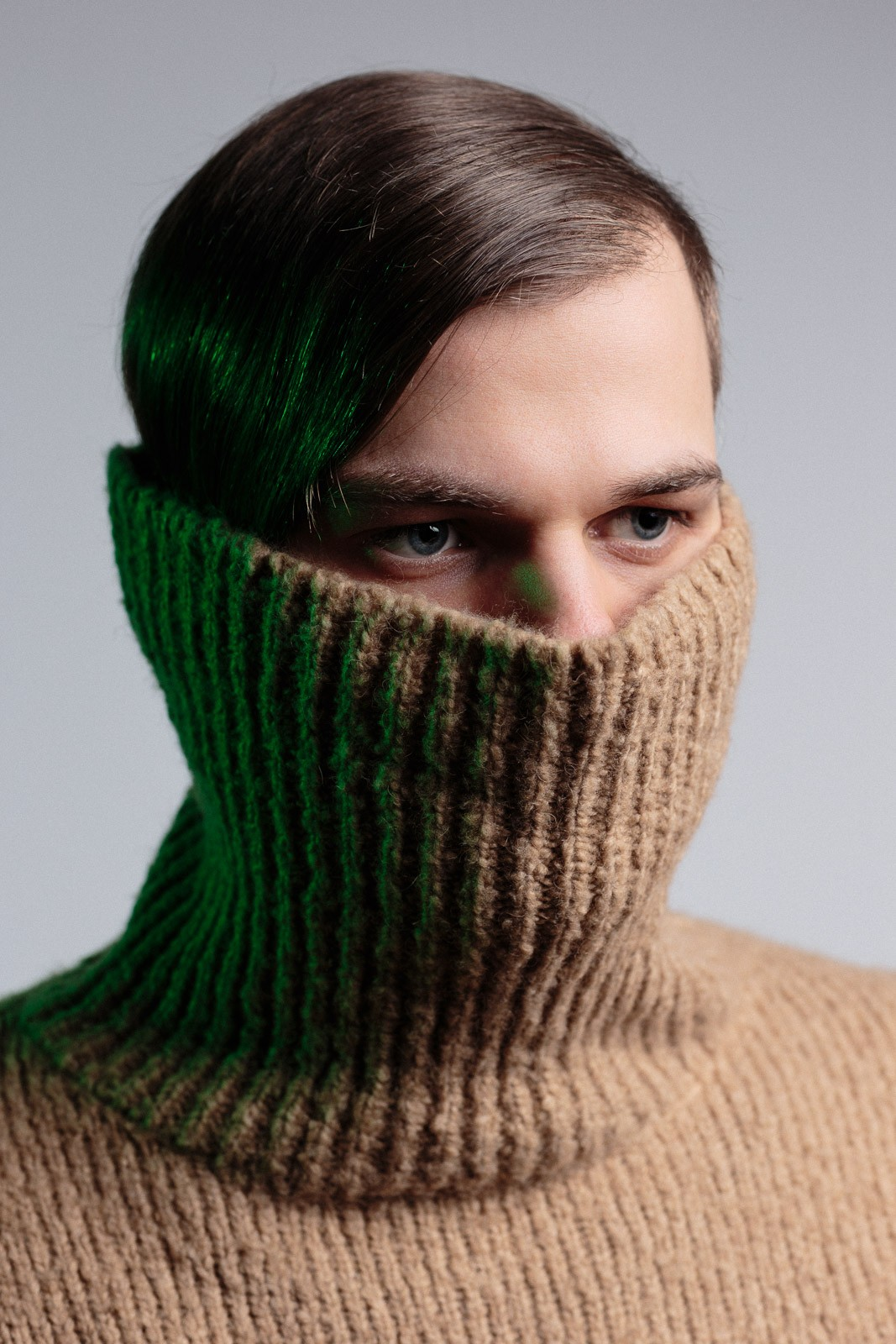 young man studio portrait wearing brown turtleneck