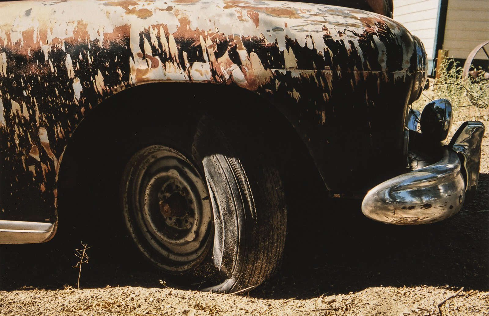 old rusty car with flat tyre