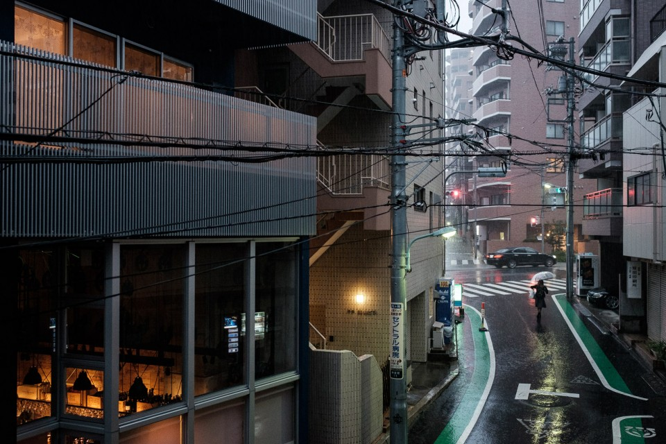 rainy mood in tokyo after typhoon with womand and umbrella